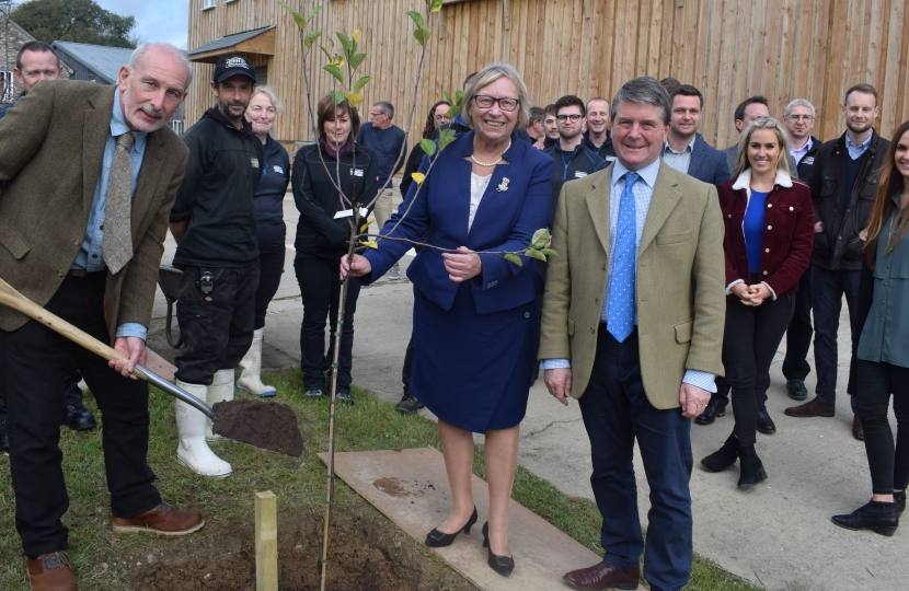 Sheryll planting the tree with Andy Atkinson